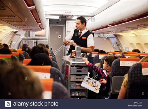Easyjet airline cabin crew staff in the plane handing out