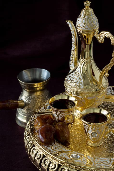 Still life with traditional golden arabic coffee set with